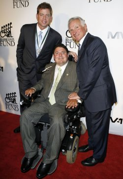 Troy Aikman, Nick and Marc Buoniconti arrive on the red carpet at the 24th Annual Great Sports Legends Dinner In New York