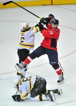 Capitals John Carlson is hit by Boston Bruins David Krejci in Washington