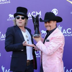 (L-R) Big Kenny and John Rich of the group Big and Rich arrive at the Academy of Country Music Awards in Las Vegas