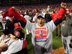 Cardinals pitcher Octavio Dotel celebrates after winning the 2011 World Series in St. Louis