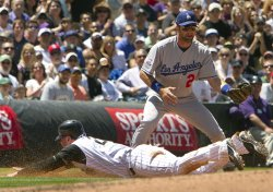 Rockies Giambi Slides Safely into Third Base Against the Dodgers Blake in Denver