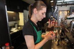 Starbucks baristas write ÒCome togetherÓ on customer cups