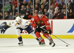 Blackhawks Kane moves puck as Predators Smith defends in Chicago