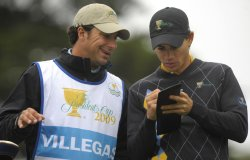 Camilo Villegas talks to his caddie during the final round of the 2009 Presidents Cup in San Francisco