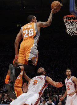 Phoenix Suns Shannon Brown drives into New York Knicks Jared Jeffries at Madison Square Garden in New York