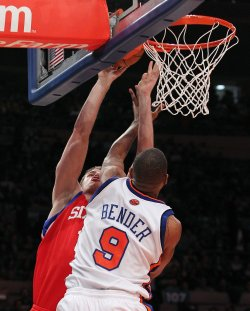 New York Knicks Jonathan Bender tries to block a shot from Philadelphia 76ers Jason Smith at Madison Square Garden