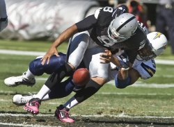 Raiders Jason Campbell sacked by Chargers in Oakland, California