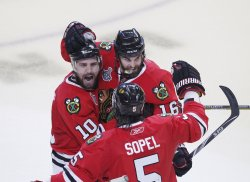 Sharp, Ladd and Sopel celebrate goal during the 2010 Stanley Cup Final