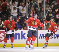 Blackhawks Kopecky, Campbell, Dowell celebrate goal against Red Wings in Chicago