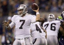 Oakland Raiders' quarterback Matt Leinart passes against the Seattle Seahawks' in a pre-season game at CenturyLink Field in Seattle