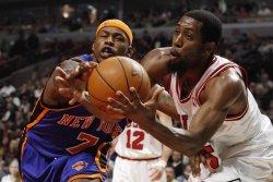 Knicks' Harrington and Bulls' Salmons go for ball in Chicago