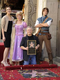 Alan Menken poses with singer Mandy Moore after receiving a star on the Hollywood Walk of Fame