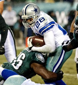 Dallas Cowboys Felix Jones is brought down by Philadelphia Eagles Omar Gaither in the first