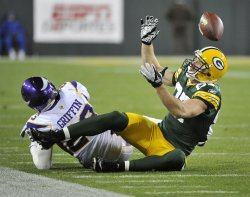 Vikings Griffin breaks up pass intended for Packers Nelson in Green Bay, Wisconsin