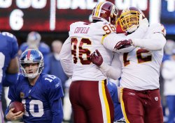 Washington Redskins Stephen Bowen sacks New York Giants Eli Manning for an 8 yard loss at MetLife Stadium in New Jersey