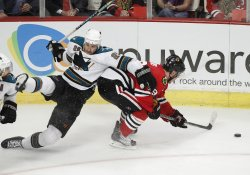 Sharks Clowe holds Blackhawks Toews in Chicago