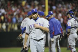 Texas Rangers pitcher yanked in the fifth inning during game 7 of World Series in St. Louis
