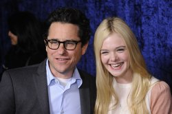 "J.J. Abrams and Elle Fanning attend a screening of ""Super 8"" in Beverly Hills, California"
