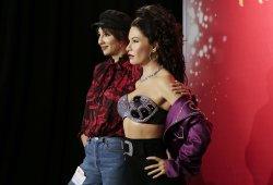 Jackie Cruz stands with wax statue of Selena