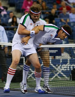 Chris Evert and Monica Seles take on Jason Biggs and Rainn Wilson in an exhibition match at the U.S. Open in New York