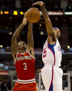 Milwaukee Bucks Brandon Jennings(L) has his shot blocked by Los Angeles Clipper Mo Williams in Los Angeles