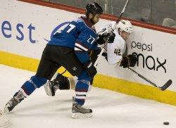 Avalanche Quincey Slams Ducks Sexton into Boards in Denver