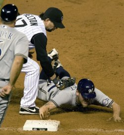 Brewers Hart Safe at First on Tag by Rockies Helton in Denver