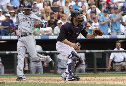 Brewers Escobar Scores in Ninth Against the Rockies in Denver