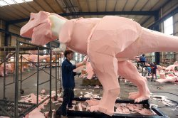 Chinese workers sculpt models of dinosaurs in Zigong, China