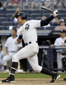 New York Yankees Alex Rodriguez hits a solo homer at Yankees Stadium in New York