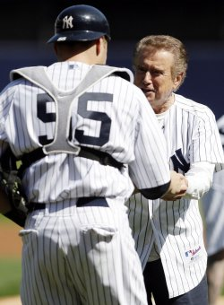 Regis Philbin throws out the first pitch at Yankee Stadium in New York