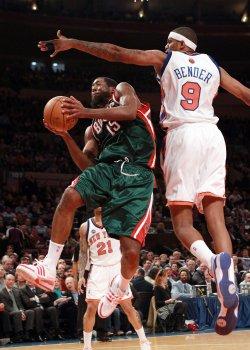 Milwaukee Bucks John Salmons leaps under New York Knicks Jonathan Bender at Madison Square Garden