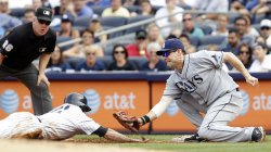 New York Yankees Brett Gardner is tagged out at Tampa Bay Rays Casey Kotchman at Yankee Stadium in New York