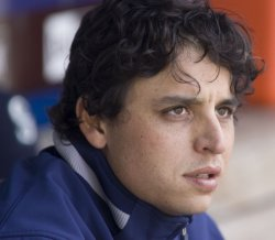 Seattle Mariners' starter Jason Vargas watches from the dugout after being relieved in the eight inning against tge Los Angeles Angels.