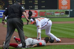 Red Sox Xander Bogaerts slides safely into third base ahead of Orioles' Manny Machado