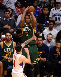 Jazz guard Rodney Hood shoots a three pointer over Clippers guard JJ Reddick in Los Angeles