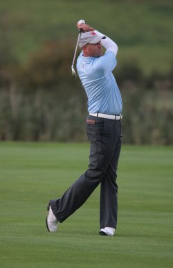 Stewart Cink plays a shot on 8th fairway on the first day of Ryder Cup.