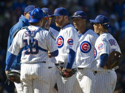 Cubs Dempster Stands on Mound on Opening Day in Chicago