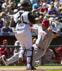 Reds Janish Scores Against the Rockies in Denver