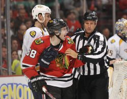 Predators' Weber and Referee Hold Back Kane in Chicago