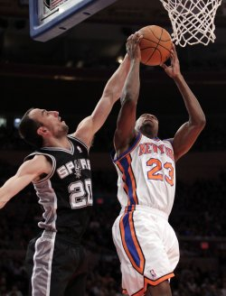 San Antonio Spurs Manu Ginobili plays defense on New York Knicks Toney Douglas at Madison Square Garden in New York
