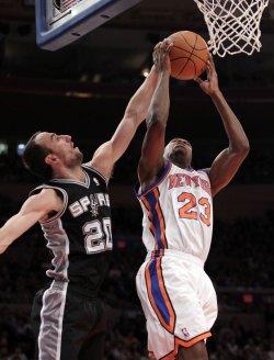 San Antonio Spurs Manu Ginobili plays defense on New York Knicks Toney Douglas at Madison Square Garden in New York
