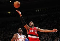 Portland Trail Blazers LaMarcus Aldridge drives to the basket by New York Knicks Amar'e Stoudemire at Madison Square Garden in New York