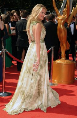 Rebecca Romijn arrives at the Primetime Creative Arts Emmy Awards in Los Angeles