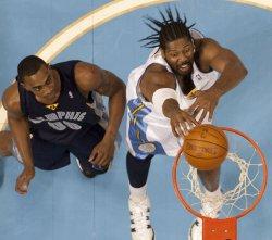 Nuggets Nene Dunks Against Grizzlies Arthur in Denver