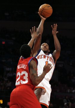 New York Knicks Chris Duhon shoots over Philadelphia 76ers Louis Williams in the first quarter at Madison Square Garden in New York City