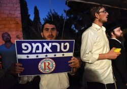 "An Orthodox Jew Holds A Sign In Hebrew Reading ""Trump"" At A Rally In Jerusalem"