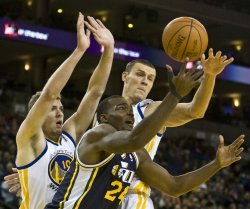 Utah Jazz Paul Milsap reaches for a loose ball in Oakland, California