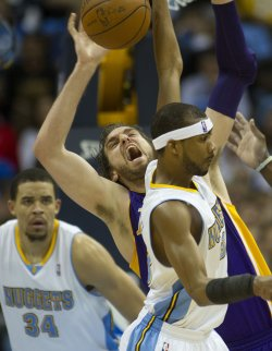 Lakers Gasol Loses Ball Against the Nuggets McGee and Brewer During the NBA Western Conference Playoffs First Round Game Four in Denver