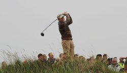 Tom Watson tees off on the 10th hole during the Open Championship in England.